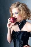 Biting red apple Stock Image