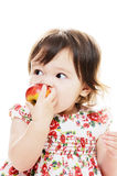 Biting red apple Royalty Free Stock Images