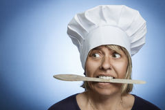 Biting a wooden spoon Stock Photo