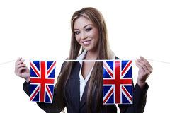 Bitish flag. Woman holding british flag bunting  out Royalty Free Stock Photography