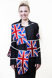 Bitish flag. Woman wrapped up in british flag bunting Stock Image