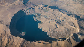 Bitlis, Turkey - September 30, 2013: Nemrut dagi is a dormant volcano in Bitlis.  Nemrut lake occupies nearly half of the caldera. Royalty Free Stock Image