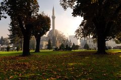 BITOLA, MACEDONIA - OCTOBER 27, 2014: a view of Bitola city park and Ajdar Kadi mosque, built 1560 by Sinan the architect Royalty Free Stock Image