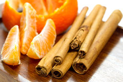 Bits of orange and cinnamon sticks Royalty Free Stock Photos