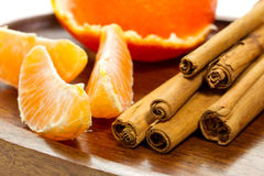 Bits of orange and cinnamon sticks Royalty Free Stock Photo