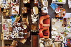 Bits and pieces in a flea market. High-angle shot of a stall in a flea market full of bits and pieces stock photo