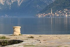 Bitt on a pier close up on a background of Kotor bay Royalty Free Stock Photo