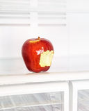 Bitten apple in the fridge Royalty Free Stock Image