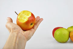 Bitten apple in a hand Stock Photography