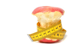 Bitten apple and measure tape Stock Photography