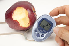 Bitten Apple And Pedometer Stock Photo
