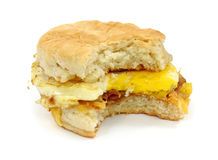 Bitten bacon egg cheese breakfast sandwich Royalty Free Stock Images