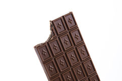 Bitten bar. Picture of bitten chocolate bar on white background Stock Photography