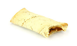 Bitten bean burrito. A freshly baked bean burrito that has been bitten on a white background royalty free stock photo