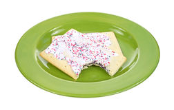 Bitten blueberry toaster pastry on plate Stock Photos