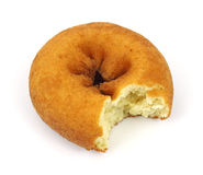 Bitten cake donut. A single bitten cake donut on a white background royalty free stock photo