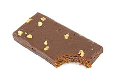 Bitten chocolate brownie with nuts Stock Photography