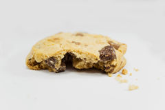 Bitten chocolate chip cookie, close up. Bitten chocolate chip cookie on white background, close up Royalty Free Stock Photography