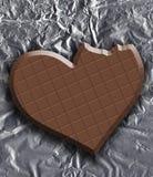 Bitten of chocolate heart stock photography