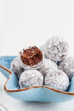 Bitten chocolate truffle in sugar powder Royalty Free Stock Images