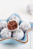 Bitten chocolate truffle in sugar powder Stock Images
