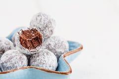 Bitten chocolate truffle in sugar powder Stock Photography