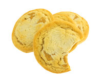 Bitten chunky peanut butter cookie in front of cookies. A bitten chunky peanut butter cookie in front of more cookies isolated on a white background royalty free stock photo