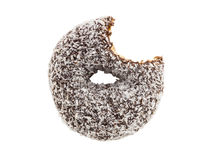 Bitten coconut chocolate donut isolated on white background Royalty Free Stock Images