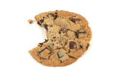 Bitten Cookie. One chocolate chip cookie with bite in it on a white background Royalty Free Stock Photos