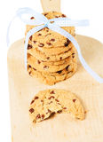 Bitten cookie with stacked cookies Royalty Free Stock Photo