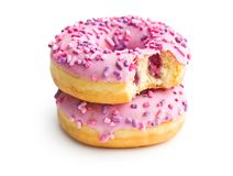 A bitten donut. A bitten donut isolated on white background Royalty Free Stock Images