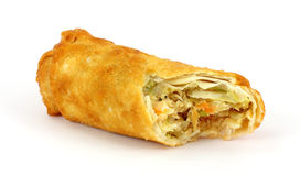 Bitten egg roll. An egg roll that has been bitten on a white background royalty free stock photos