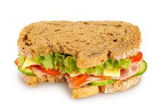 Bitten fresh sandwich (Clipping path included). Bitten fresh sandwich (whole grain bread) on white background. Clipping path included Stock Image