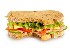 Bitten fresh sandwich (Clipping path included). Bitten fresh sandwich (whole grain bread) on white background. Clipping path included Royalty Free Stock Photos