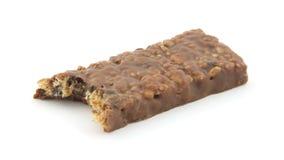Bitten fudge dipped granola bar Royalty Free Stock Photo