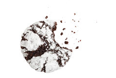 Bitten homemade chocolate crinkle cookie powdered sugar. And crumbs on white background. Top view Royalty Free Stock Photography