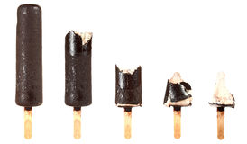 Bitten ice cream with chocolate on a stick Royalty Free Stock Images