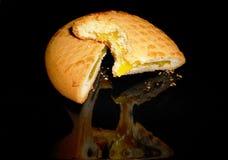Bitten lemon pie on a black plate Stock Image