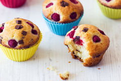 Bitten muffin on white table Stock Images