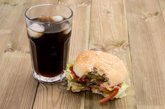 Bitten Off Burger with Softdrink Royalty Free Stock Photos