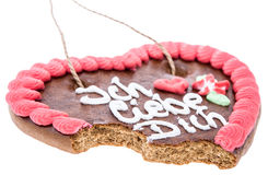 Bitten off Gingerbread Heart on white Stock Photography
