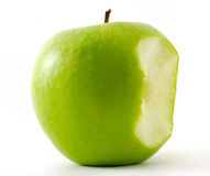 The bitten off green apple. On white Stock Image