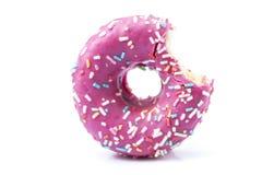 Bitten pink glazed donut Stock Images