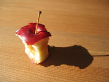Bitten Red Apple. On Antic Wood Table Close-up. Apple picking - fun family activity of the Fall Royalty Free Stock Photos