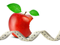 Bitten red apple with measuring tape Royalty Free Stock Images