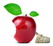 Bitten red apple with measuring tape Stock Images
