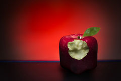 Bitten, red cube apple Royalty Free Stock Photo