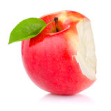 Bitten red juicy apple with green leaf isolated Royalty Free Stock Photo