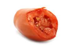 Bitten red tomato. On the white background Royalty Free Stock Photography