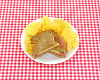 Bitten sandwich with chips Royalty Free Stock Photography